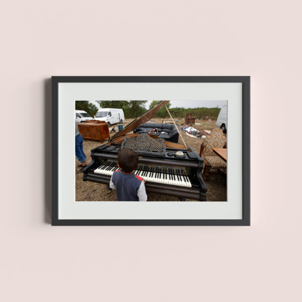 ŠABAC, SERBIA - September 19, 2011: Gypsy child plays large concert piano at the traditional Šabac Fair.